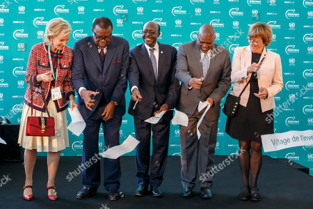 (l-r) Princess Astrid of Belgium, President of Namibia Hage Geingob, UNCTAD Secretary-General  Mukhisa Kituyi, Botswana President Mokgweetsi Masisi, and Deputy Secretary-General of UNCTAD Isabelle Durant cut the ribbon during the inauguration of Investment Village of the World Investment Forum 2018, at the European headquarters of the United Nations in Geneva, Switzerland, 22 October 2018. The UNCTAD (United Nations Conference on Trade and Development) runs from 22 to 26 October 2018 under the overall theme 'Investing in Sustainable Development'.