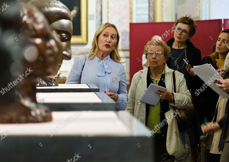 "French art historian Diana Widmaier Picasso, left, granddaughter of artist Pablo Picasso, tours journalists through the exhibition ""Picasso, the sculpture"" at Rome's Galleria Borghese, during a preview for the media. The exhibition, presenting 56 masterpieces by Picasso executed between 1905 and 1964 will open on Oct. 24 through Feb. 3, 2019"