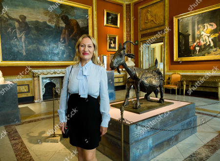 "French art historian Diana Widmaier Picasso, granddaughter of artist Pablo Picasso, poses with her grandfather's 1950 sculpture ""She-goat"", on display at the exhibition ""Picasso, the sculpture"" at Rome's Galleria Borghese, during a preview for the media. The exhibition, presenting 56 masterpieces by Picasso executed between 1905 and 1964 will open on Oct. 24 through Feb. 3, 2019"