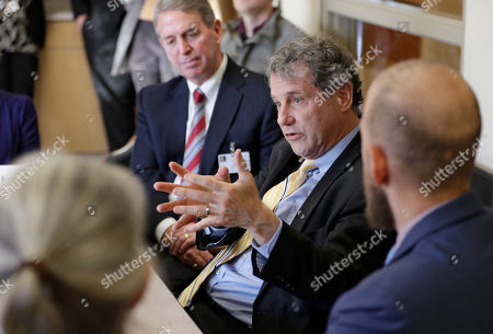 Sen. Sherrod Brown, D-Ohio, participates in a roundtable discussion with addiction treatment professionals and patients at St. Vincent Charity Medical Center, in Cleveland. Brown was in Cleveland to discuss the passage of his bill to help more Ohioans access treatment for substance use disorders