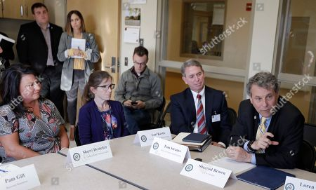 Sen. Sherrod Brown, D-Ohio, right, participates in a roundtable discussion with addiction treatment professionals and patients at St. Vincent Charity Medical Center, in Cleveland. Brown was in Cleveland to discuss the passage of his bill to help more Ohioans access treatment for substance use disorders