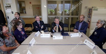 Sen. Sherrod Brown, D-Ohio, center, participates in a roundtable discussion with addiction treatment professionals and patients at St. Vincent Charity Medical Center, in Cleveland. Brown was in Cleveland to discuss the passage of his bill to help more Ohioans access treatment for substance use disorders
