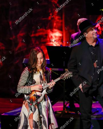 Sierra Hull, Garth Brooks. Sierra Hull performs as Garth Brooks listens at the 2018 Medallion Ceremony at the Country Music Hall of Fame and Museum, in Nashville, Tenn