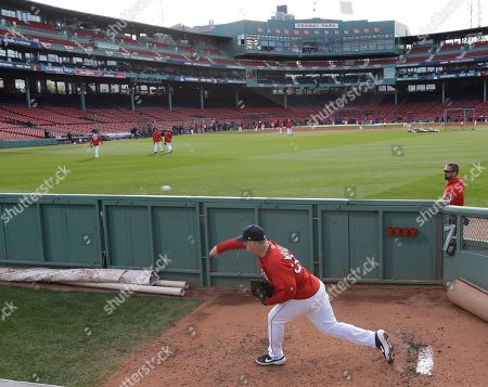 Boston Red Sox pitcher Steven Wright warms up during batting practice for the World Series baseball game, in Boston. The Red Sox play the Los Angeles Dodgers in Game 1 on Tuesday, Oct. 23, 2018