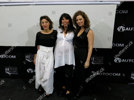 Alejandra Marquez, Ilse Salas, Johanna Murillo. Mexican director Alejandra Marquez, center, poses for a group photo with Mexican actors Ilse Salas, left, and Johanna Murillo, during a press conference about their Mexican film Las Ninas Bien or Good Girls at the Morelia Film Festival in Morelia Mexico, Monday, Oct. 22. 2018