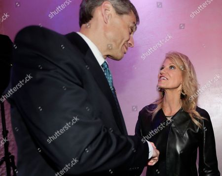 Republican congressional candidate Jay Webber shakes hands with White House counselor Kellyanne Conway after she spoke at a reception in Wayne, N.J., . Webber is running against Democrat Mikie Sherrill; the race is among the most closely watched this year as Republicans defend their House majority and Democrats hope to flip about two dozen seats to take control