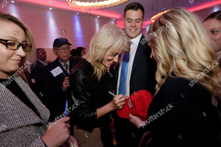 """White House counselor Kellyanne Conway signs a """"Make America Great Again"""" hat after speaking in support of Republican congressional candidate Jay Webber at an event in Wayne, N.J., . Webber is running against Democrat Mikie Sherrill; the race is among the most closely watched this year as Republicans defend their House majority and Democrats hope to flip about two dozen seats to take control"""