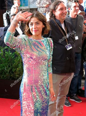 """Mexican actress Ilse Salas waves from the red carpet event for the Mexican film """"Ninas Bien"""" at the Morelia Film Festival in Morelia, Mexico, Monday, Oct. 22. 2018"""