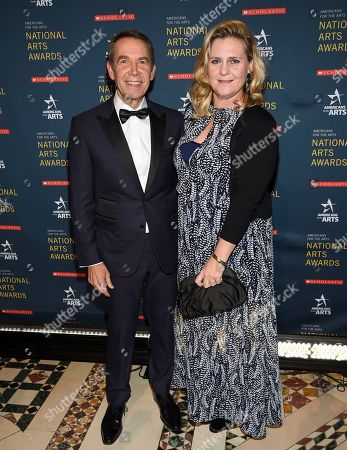 Stock Picture of Jeff Koons, Justine Wheeler. Artist Jeff Koons, left, and wife Justine Wheeler attend the 2018 National Art Awards, hosted by Americans for the Arts, at Cipriani 42nd Street, in New York