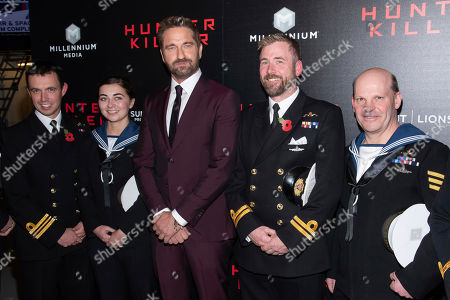 Gerard Butler, center, poses with sailors from the Royal Navy's HMS Queen Elizabeth II
