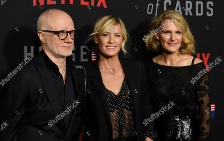 """Frank Pugliese, Robin Wright, Melissa James Gibson. Robin Wright, center, star of """"House of Cards,"""" poses with executive producers Frank Pugliese, left, and Melissa James Gibson at the season six premiere of the Netflix political drama series, in Los Angeles"""