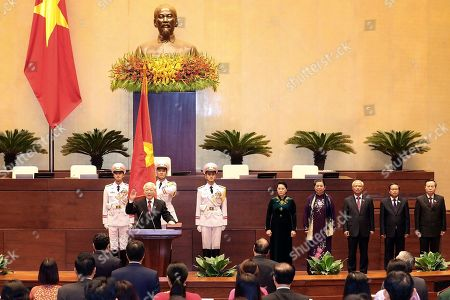 Stock Photo of Vietnam's General Secretary Nguyen Phu Trong takes the oath of office after being elected as President of Vietnam in Hanoi, Vietnam, 23 October 2018. Trong, 74, already General Secretary of the Communist Party of Vietnam, was elected by the National Assembly after the death of Tran Dai Quang in September.