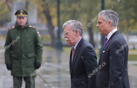 US National Security Advisor John Bolton (C) and US ambassador to Russia Jon Huntsman (R) attend a wreath-laying ceremony at the Tomb of the Unknown Soldier in the Alexandrovsky Garden near the Kremlin wall in Moscow, Russia, 23 October 2018. John Bolton arrived in Moscow on a three-days visit to discuss questions of strategic stability, Ukraine, Syria, N. Korea Afghanistan and possible Russia-U.S. summit. The visit comes two days after US President Trump announced his intention to pull out from the 1987 Intermediate-Range Nuclear Forces