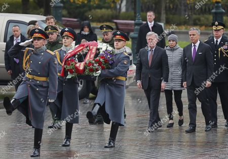 US National Security Advisor John Bolton (4-R) and US ambassador to Russia Jon Huntsman (2-R) attend a wreath-laying ceremony at the Tomb of the Unknown Soldier in the Alexandrovsky Garden near the Kremlin wall in Moscow, Russia, 23 October 2018. John Bolton arrived in Moscow on a three-days visit to discuss questions of strategic stability, Ukraine, Syria, N. korea, Afghanistan and possible Russia-U.S. summit. The visit comes two days after US President Trump announced his intention to pull out from the 1987 Intermediate-Range Nuclear Forces