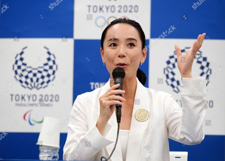 Japanese film director Naomi Kawase speaks during a press conference in Tokyo, . Kawase was named to make the documentary film about Tokyo's 2020 Olympics. She said she hoped to focus partly on reconstruction efforts in the northern Fukushima region of Japan, which was devastate by an earthquake and tsunami in 2011 and a resulting nuclear disaster