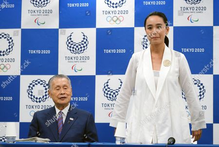 Naomi Kawase, Yoshiro Mori. Japanese film director Naomi Kawase, right, is introduced to the media next to Tokyo Olympic organizing committee President Yoshiro Mori during a press conference in Tokyo, . Kawase was named to make the documentary film about Tokyo's 2020 Olympics. She said she hoped to focus partly on reconstruction efforts in the northern Fukushima region of Japan, which was devastate by an earthquake and tsunami in 2011 and a resulting nuclear disaster