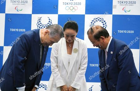Naomi Kawase, Yoshiro Mori, Toshiro Muto. Japanese film director Naomi Kawase, center, Tokyo Olympic organizing committee President Yoshiro Mori, left, and Toshiro Muto, right, CEO of the Tokyo Organizing Committee of the Olympic and Paralympic Games, bow to each other after a press conference in Tokyo, . Kawase was named to make the documentary film about Tokyo's 2020 Olympics. She said she hoped to focus partly on reconstruction efforts in the northern Fukushima region of Japan, which was devastate by an earthquake and tsunami in 2011 and a resulting nuclear disaster
