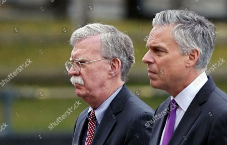 US ambassador to Russia Jon Huntsman (R) and US National Security Advisor John Bolton (L) attend a wreath-laying ceremony at the memorial stone in the Alexander Garden near the Kremlin in memory of the victims of an attack on a vocational college in the Crimean city of Kerch, in Moscow, Russia, 23 October 2018. John Bolton arrived in Moscow on a three-days visit to discuss questions of strategic stability, Ukraine, Syria, N. Korea, Afghanistan and possible Russia-U.S. summit. The visit comes two days after US President Trump announced his intention to pull out from the 1987 Intermediate-Range Nuclear Forces.