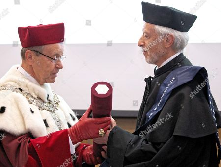 South African Nobel Prize of Literatue John Maxwell Coetzee (R) receives a honorary degree Doctor Honoris Causa of the University of Silesia from the rector prof. Andrzej Kowalczyk (L) during a ceremony in Katowice, Poland, 23 October 2018.