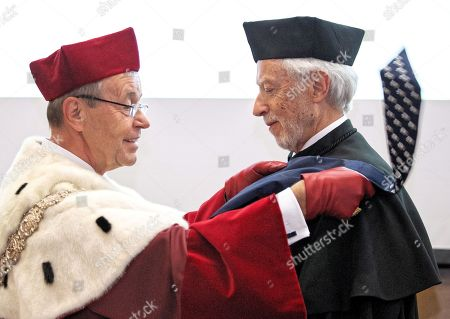 Stock Picture of South African Nobel Prize of Literatue John Maxwell Coetzee (R) receives a honorary degree Doctor Honoris Causa of the University of Silesia from the rector prof. Andrzej Kowalczyk (L) during a ceremony in Katowice, Poland, 23 October 2018.