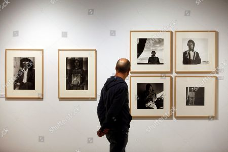 A visitor looks at works by Mexican photographer Graciela Iturbide during the press preview of an exhibition on Iturbe at the Barrie Foundation in La Coruna, province of Galicia, northwestern Spain, 23 October 2018. The exhibition featuring 156 photographs will run from 24 October to 27 January 2019.