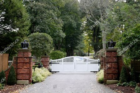 """The gate is closed at the entrance to a house owned by philanthropist George Soros in Katonah, N.Y., a suburb of New York City, . A device found outside the compound """"had the components"""" of a bomb, including explosive powder, a law enforcement official said Tuesday"""