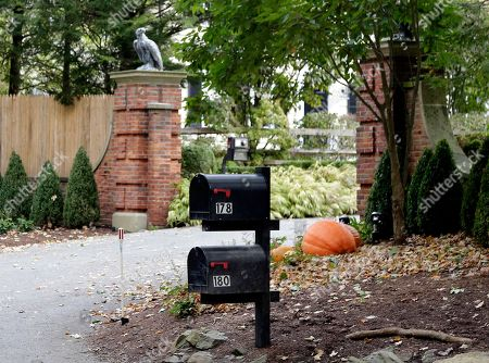 """Mailboxes stand outside the entrance to a house owned by philanthropist George Soros in Katonah, N.Y., a suburb of New York City, . A device found outside the compound """"had the components"""" of a bomb, including explosive powder, a law enforcement official said Tuesday"""