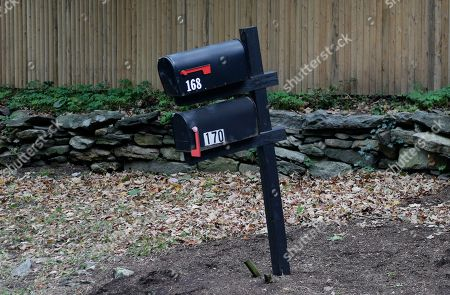 """Mailboxes in front of a compound owned by George Soros are seen in Katonah, N.Y., . A device found outside a suburban New York residential compound owned by liberal philanthropist Soros """"had the components"""" of an actual bomb, including explosive powder, a law enforcement official said Tuesday"""