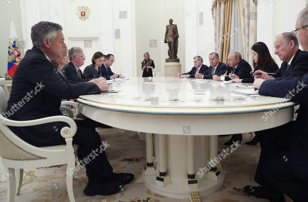 Russian Security Council Secretary Nikolai Patrushev (R), Russian President Vladimir Putin (3-R) and Russian Foreign Minister Sergei Lavrov (4-R) attend a meeting with US National Security Adviser John Bolton (3-L) and US Ambassador to Russia Jon Huntsman (L), in the Kremlin Moscow, Russia, 23 October 2018. John Bolton arrived in Moscow on a three-days visit to discuss questions of strategic stability, Ukraine, Syria, N. Korea, Afghanistan and possible Russia-US summit. The visit comes two days after US President Trump announced his intention to pull out from the 1987 Intermediate-Range Nuclear Forces Treaty.