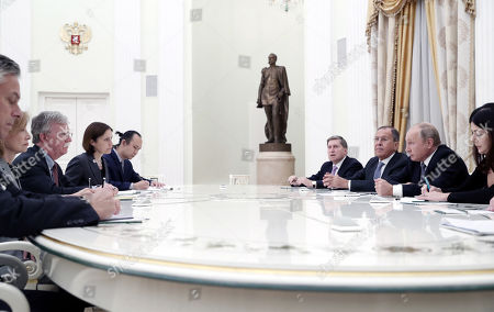 Russian President Vladimir Putin (2-R) and Russian Foreign Minister Sergei Lavrov (3-R) attend a meeting with US National Security Adviser John Bolton (3-L) and US Ambassador to Russia Jon Huntsman (L, partly seen), in the Kremlin Moscow, Russia, 23 October 2018. John Bolton arrived in Moscow on a three-days visit to discuss questions of strategic stability, Ukraine, Syria, N. Korea, Afghanistan and possible Russia-US summit. The visit comes two days after US President Trump announced his intention to pull out from the 1987 Intermediate-Range Nuclear Forces Treaty.