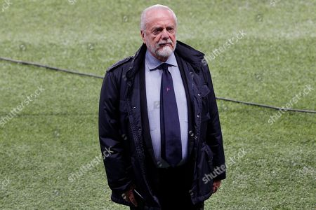 Napoli soccer club president Aurelio De Laurentis stands on the pitch during a training session, at the Parc des Princes stadium in Paris, . PSG will play against Napoli in a Champions League group C Champions League soccer match on Wednesday