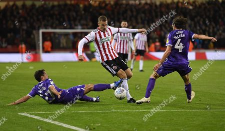 Paul Coutts of Sheffield United beats Bojan Krkic and Joe Allen of Stoke City