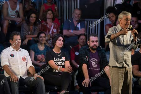 The Brazilian singer Caetano Veloso speaks during a campaign event with popular Brazilian artists and musicians in support Fernando Haddad, left behind, Brazil's presidential candidate for the Workers Party in Rio de Janeiro, Brazil, . Haddad will face Jair Bolsonaro, a far-right congressman, in a presidential runoff on Sunday