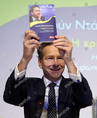 Dutch former Eurogroup chief Jeroen Dijsselbloem shows the book during the presentation of the Greek edition of his book titled 'The Euro Crisis' in Athens Greece, 23 October 2018.
