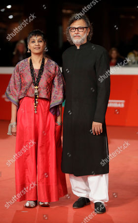 """Director Rakeysh Omprakash Mehra, right, and Producer Bharathi Mehra pose during the red carpet of the movie """"My Dear Prime Minister"""", at the 13th edition of the Rome Film Fest, in Rome"""