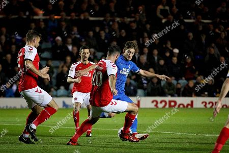 Peterborough United midfielder Alex Woodyard (4) gets tackled bt Fleetwood Town defender Craig Morgan (20) during the EFL Sky Bet League 1 match between Peterborough United and Accrington Stanley at London Road, Peterborough