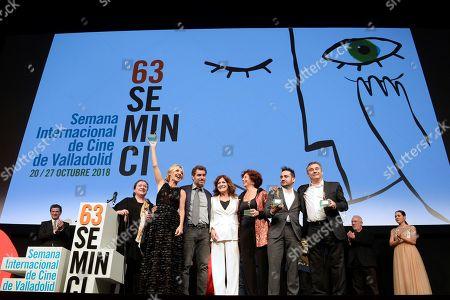 Iciar Bollain (3-R), Spanish actor Eduard Fernandez (R) and Spanish film director Juan Antonio Bayona (2-R) pose for the photographers after receiving the Espiga de Honor Award during Seminci Film Festival in Valladolid, Spain, 23 October 2018. The 63rd Seminci Film Festival takes place from 20 to 27 October.