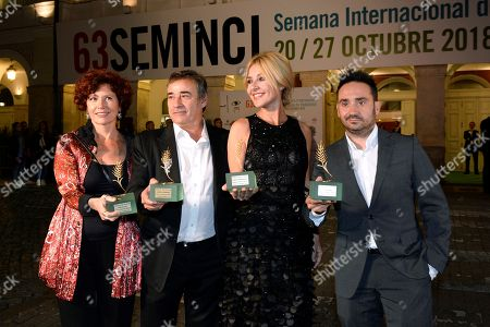 Iciar Bollain (L), Spanish actor Eduard Fernandez (2-L), Spanish TV host Cayetana Guillen Cuervo (2-R) and Spanish film director Juan Antonio Bayona (R) pose for the photographers after receiving the Espiga de Honor Award during Seminci Film Festival in Valladolid, Spain, 23 October 2018. The 63rd Seminci Film Festival takes place from 20 to 27 October.