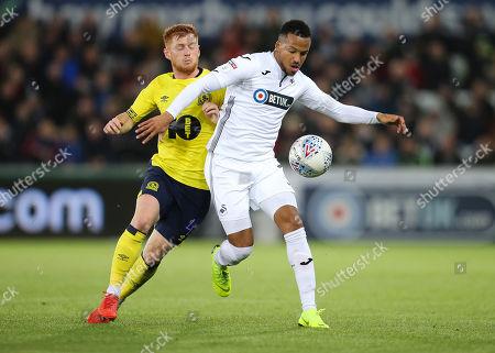 Martin Olsson of Swansea City holds off Harrison Reed of Blackburn Rovers