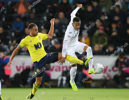 Martin Olsson of Swansea City is challenged by Elliott Bennett of Blackburn Rovers