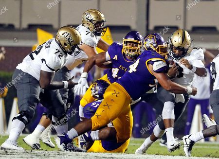 Darriel Mack Jr., Alex Turner. Central Florida's Darriel Mack Jr. (8) tries to pull away from he grasp of East Carolina's Alex Turner (94) during the first half of an NCAA college football game in Greenville, N.C