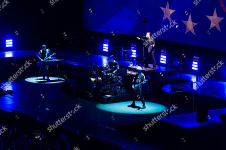 U2 - Bono, Adam Clayton, The Edge, Larry Mullen Jr Jr- performing beneath a backdrop of the EU flag in which one of the stars is filled with the Union Jack and has a heart around it
