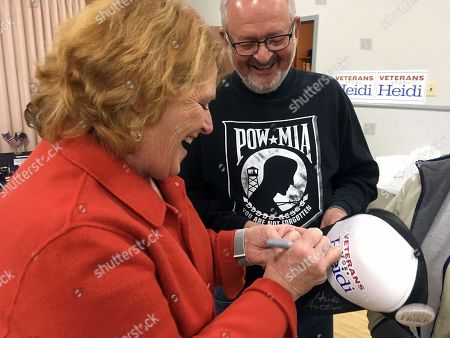 North Dakota Democratic Sen. Heidi Heitkamp signs a hat for a veteran on in Bismarck, North Dakota. Former Defense Secretary Chuck Hagel is campaigning across the state for Heitkamp, who is viewed as one of the most vulnerable candidates among red-state Democrats in the Senate