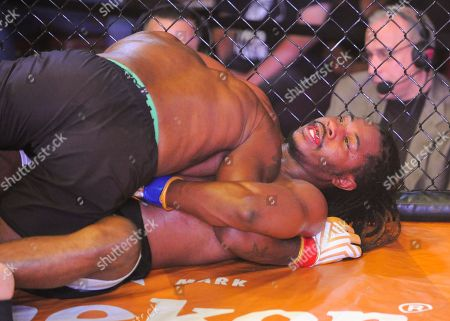 Stock Photo of MMA fighter, Terry Johnson (top), and Law Purifoy (bottom), during V3 FIGHTS 70 at the Fitz Casino in Tunica, MS. Johnson defeated Purifoy by unanimous decision