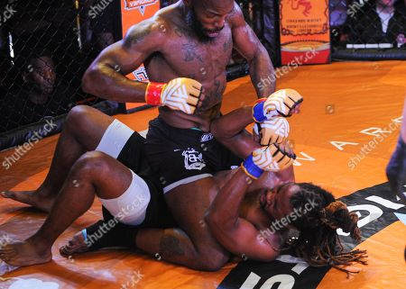 MMA fighter, Terry Johnson (top), reigns down blows on Law Purifoy (bottom), from the mounted position, during V3 FIGHTS 70 at the Fitz Casino in Tunica, MS. Johnson defeated Purifoy by unanimous decision