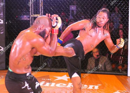 Stock Image of MMA fighter, Law Purifoy (right), delivers a kick to the stomach of Terry Johnson (left), during V3 FIGHTS 70 at the Fitz Casino in Tunica, MS. Johnson defeated Purifoy by unanimous decision