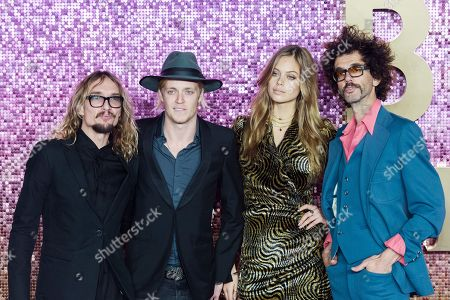 Justin Hawkins, Rufus Taylor and Frankie Poullain of the Darkness with model Jessica Clarke
