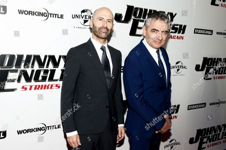 "David Kerr, Rowan Atkinson. David Kerr, left, and Rowan Atkinson, right, attend a special screening of ""Johnny English Strikes Again"" at AMC Loews Lincoln Square, in New York"