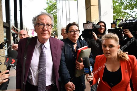 Australian actor Geoffrey Rush (C-L) and his wife Jane Menelaus (C-R) leave the Federal Court in Sydney, Australia, 24 October 2018. Australian actor Geoffrey Rush is suing Nationwide News for defamation.