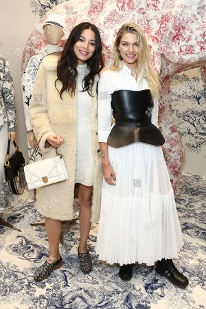 Australian models Jessica Gomes (L) and Jessica Hart attend a preview of the Christian Dior Couture Cruise 2019 Collection in Sydney, Australia, 24 October 2018.